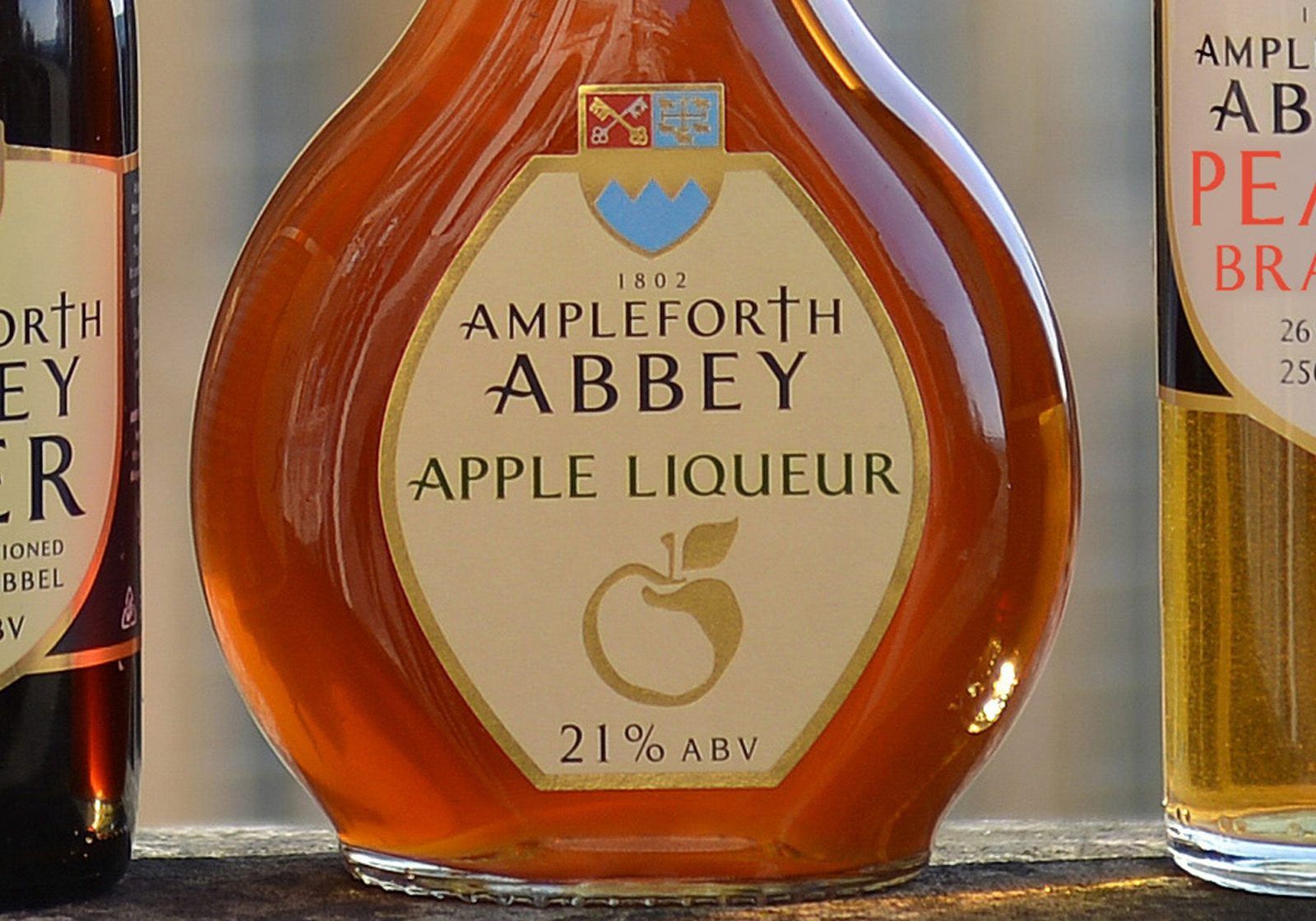Close up of a packaging label for Ampleforth Abbey Apple Liqueur