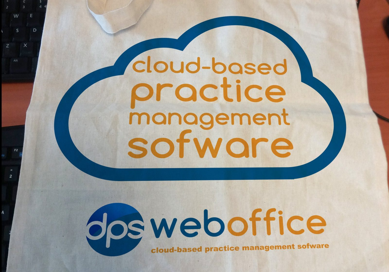 A tote bag for DPS Software showing the cloud logo and text