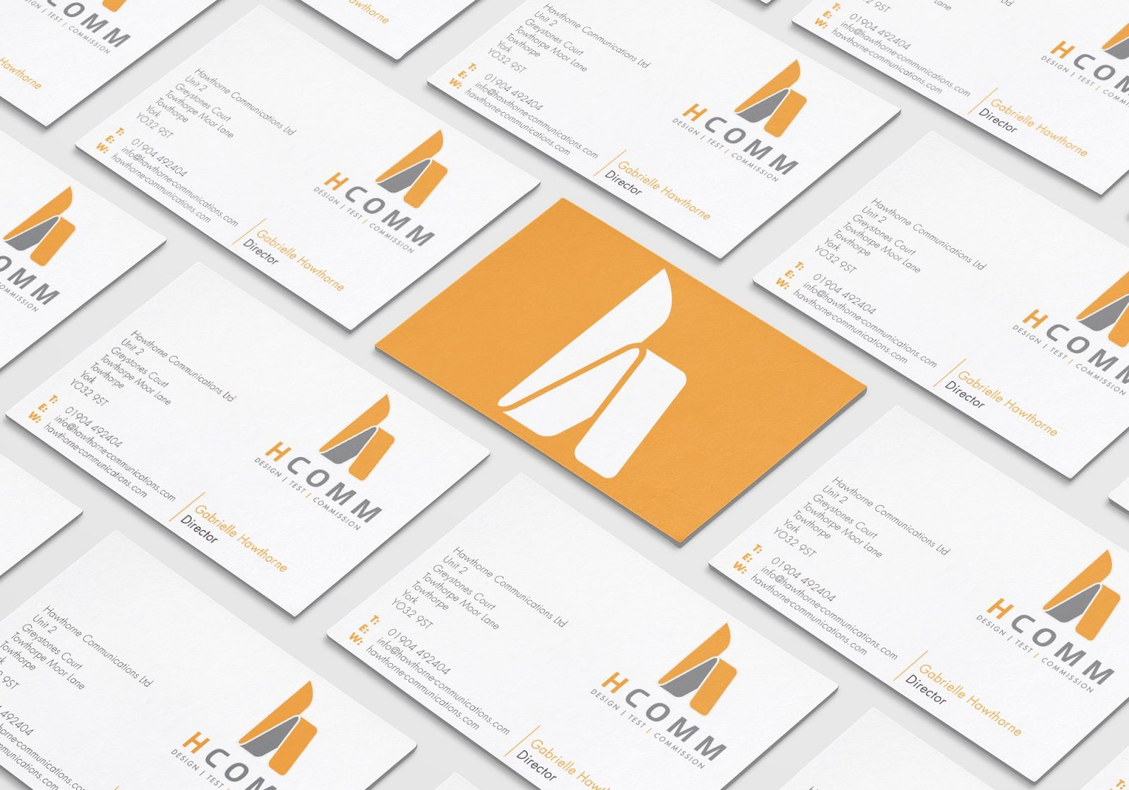 A business card design showing both sides of the design for Hcomm Rail