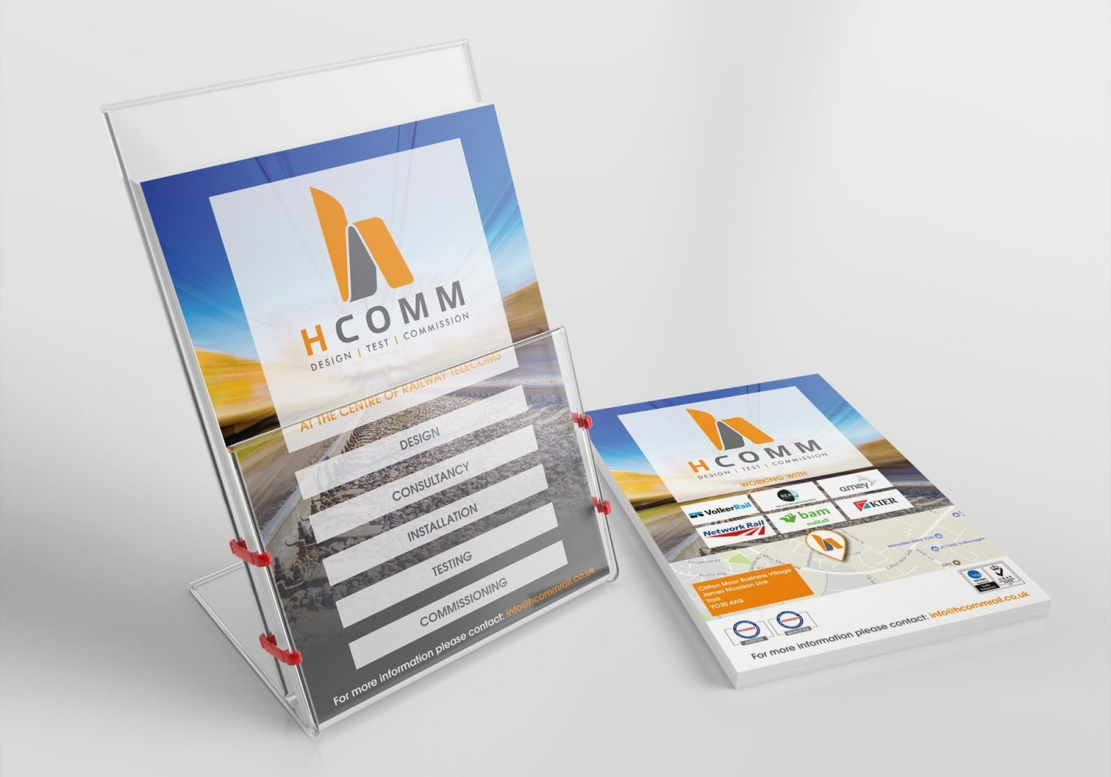 An A5 flyer in a leaflet stand for Hcomm Rail