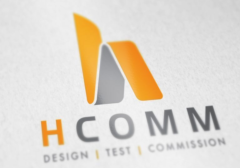 A logo close up on paper showing Hcomm Rail's logo design