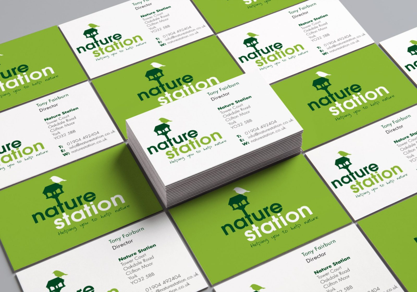 A design showing the front and back for the business card for Nature Station