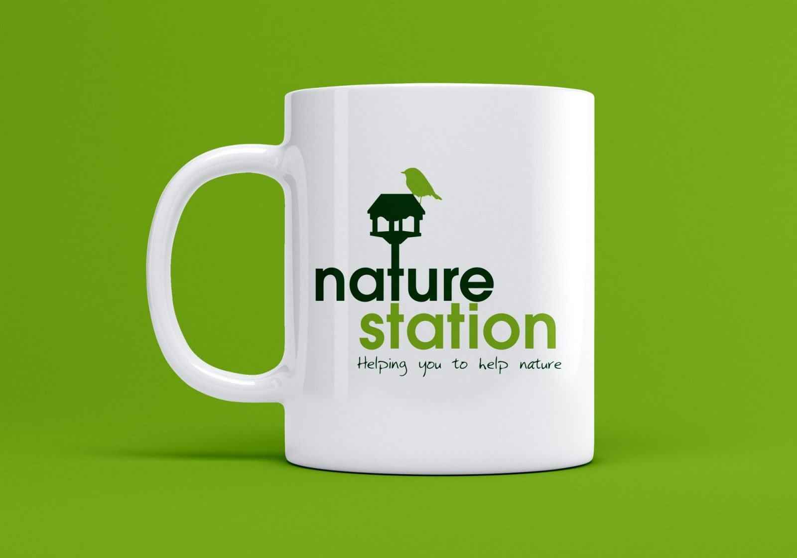 A branded mug showing the logo for Nature Station