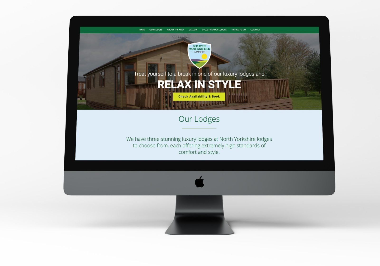 A computer showing the home page for North Yorkshire Lodges website
