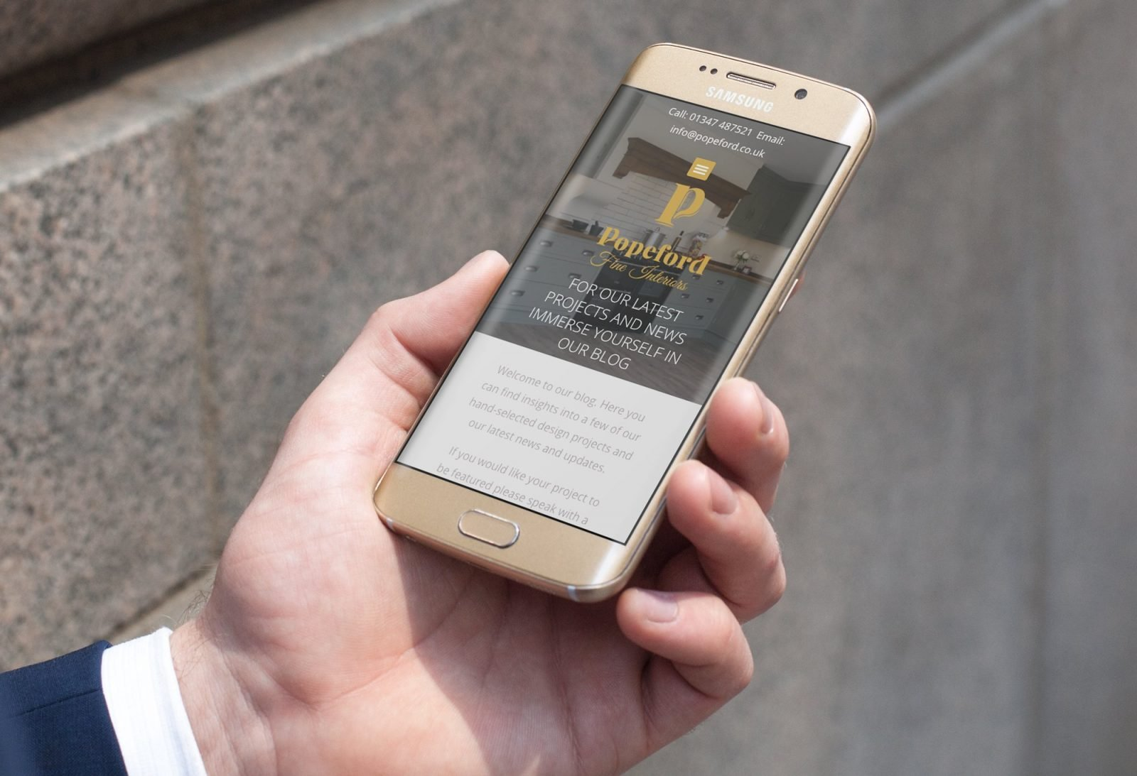 A phone showing the home page for Popeford Interior Designers website design