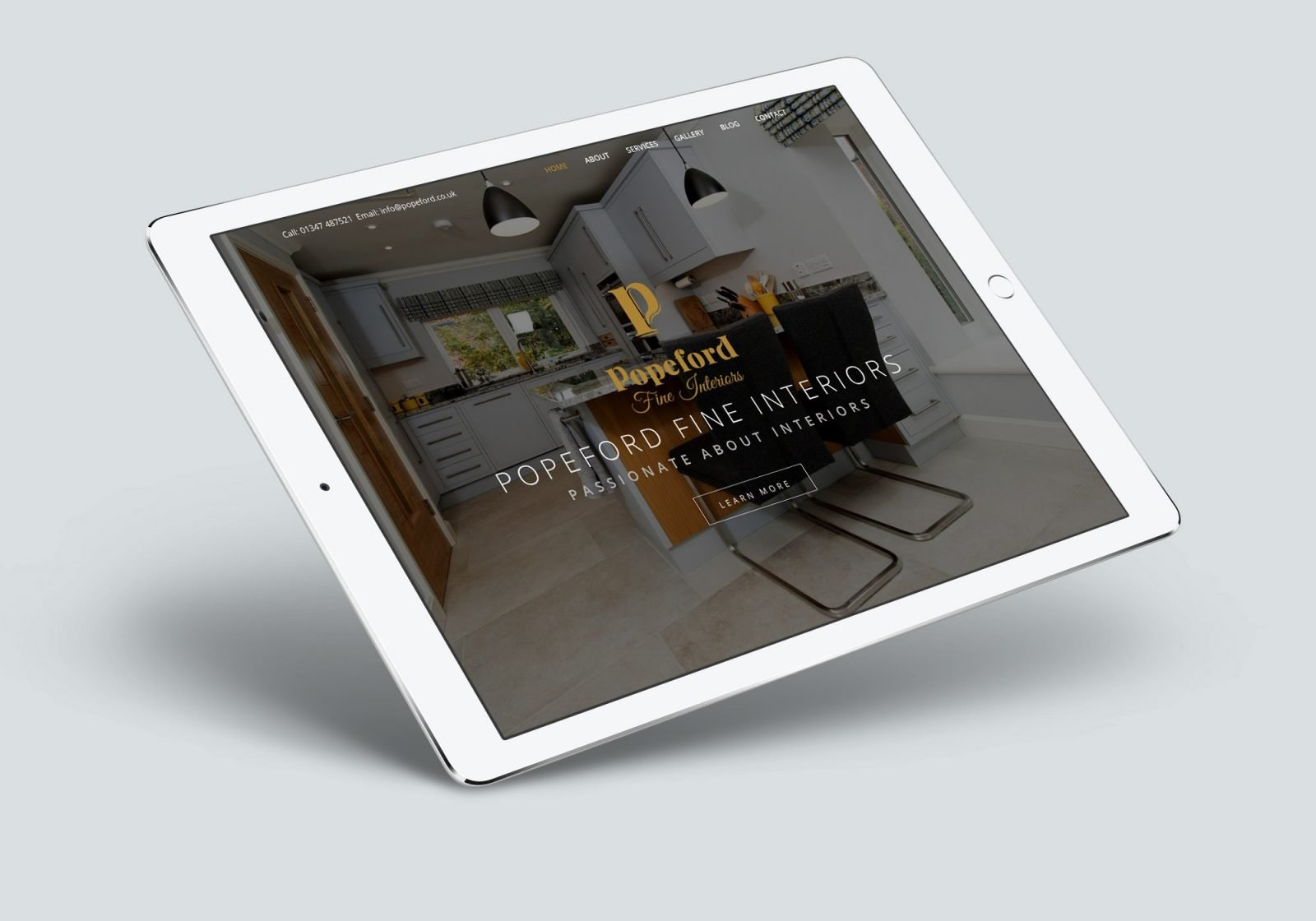 An ipad showing the home page for Popeford Interior Designers website design