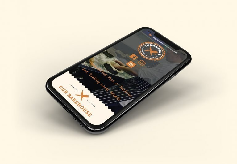 A phone showing the home page for Thornton's Butchers and Bakehouse website design